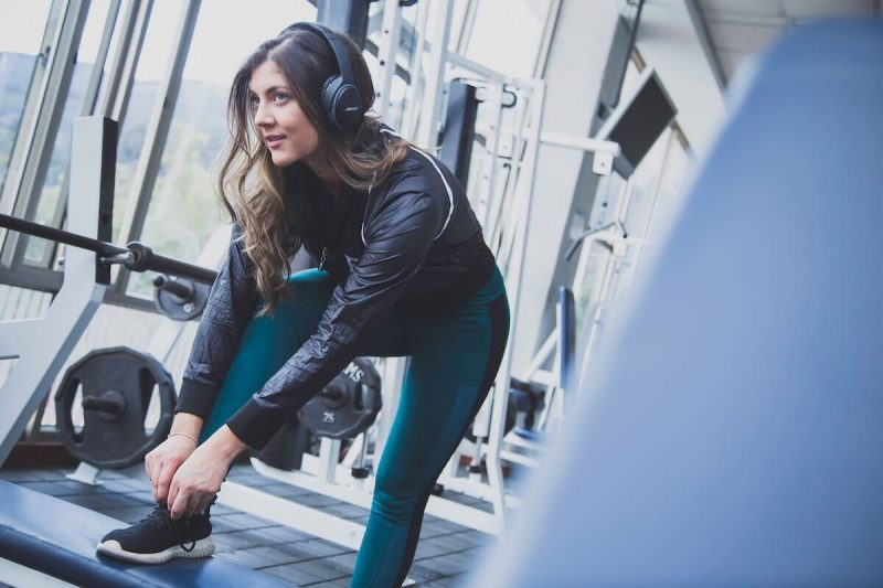 girl in workout with headphones
