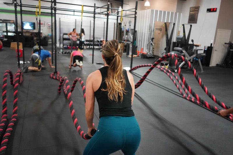 girl in gym training with others