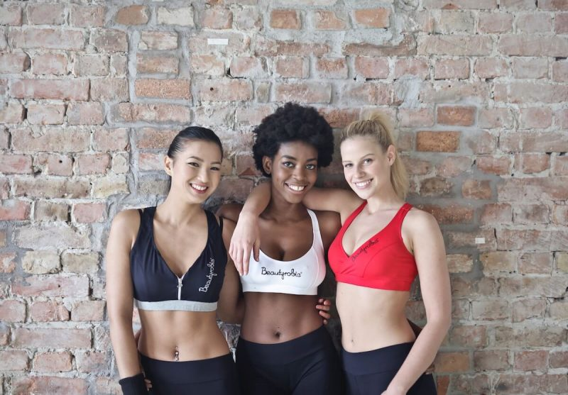 three girls in fitness clothes