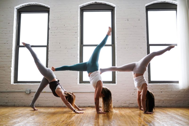 three women doing yoga exercise
