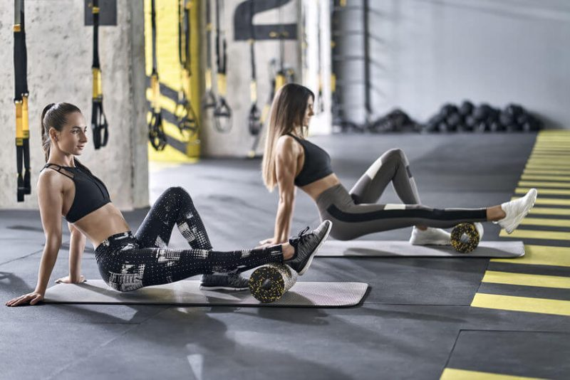 two girls training in gym