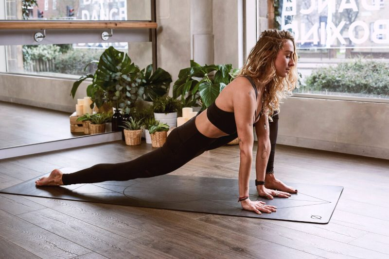 woman in black yoga pants doing yoga