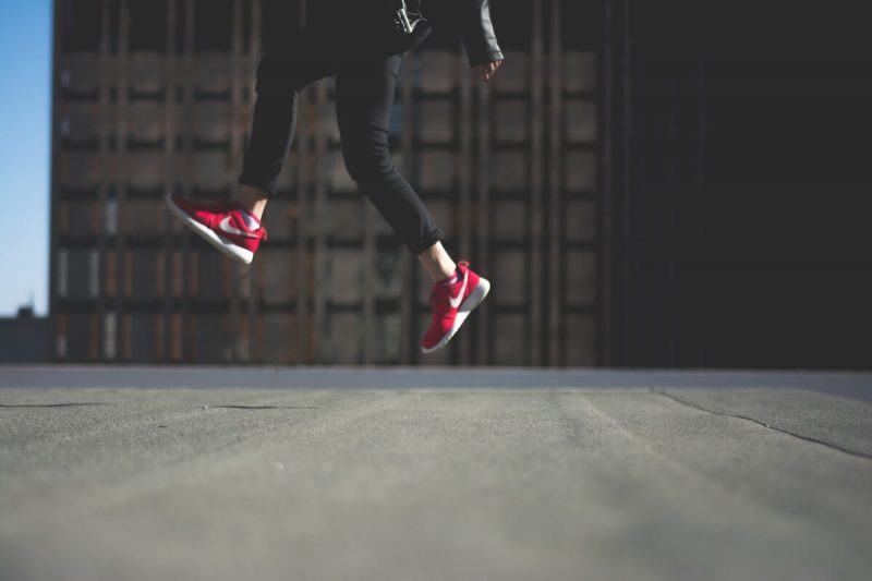 women jumping in red shoes