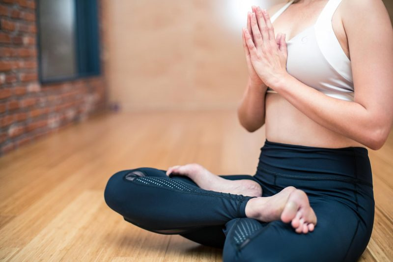 women sitting in yoga pose